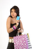 Teenage  girl with  credit card and bags. Beautiful teen girl with blank blue credit card and shopping bags Stock Image