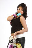 Teenage  girl with  credit card and bags. Beautiful teen girl with blank blue credit card and shopping bags Stock Images