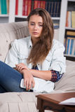 Teenage girl is crying sitting on the couch Stock Photos