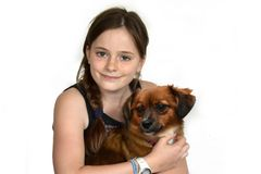 Teenage girl cuddles with her little puppy dog royalty free stock images