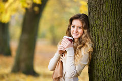 Teenage girl with cup of coffee Stock Photos