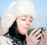 Teenage girl with cup of hot tee Stock Photo