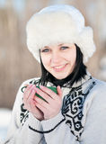 Teenage girl with cup of hot tee Stock Image