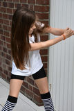 Teenage girl. Cute teenage girl tries to open a door Stock Photo