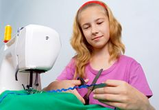 A teenage girl cuts the tape Royalty Free Stock Photos