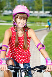 Teenage girl cycling Stock Image