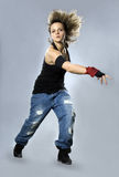 Teenage girl dancing breakdance in action Royalty Free Stock Photos