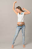 Teenage girl dancing singing enjoy music Stock Images