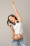 Teenage girl dancing singing with microphone Royalty Free Stock Photos