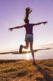 Teenage girl dancing in the sunset Stock Image