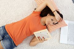 Teenage girl daydreaming at home. Teenage girl in love daydreaming at home, laying on floor, view from above Royalty Free Stock Photos