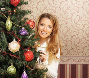 A teenage girl decorating the Christmas tree Royalty Free Stock Image