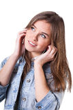 Teenage girl in denim jacket listening to music Stock Images