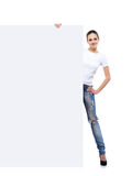 Teenage girl in denim jeans holding a blank banner Stock Photography