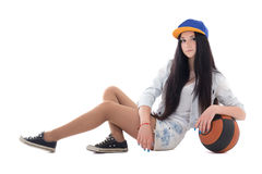Teenage girl in denim shorts with ball sitting Royalty Free Stock Image