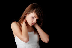 Teenage girl depression. Lost love, teen problems - isolated on black background Stock Photography