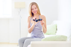 Teenage girl with digital camera Stock Photo