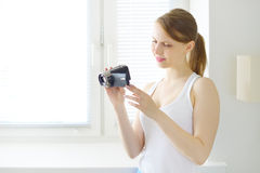 Teenage girl with digital camera Stock Image