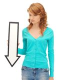 Teenage girl with direction arrow sign Royalty Free Stock Photos