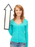Teenage girl with direction arrow sign Stock Images