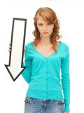 Teenage girl with direction arrow sign Stock Photo