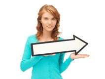 Teenage girl with direction arrow sign Stock Image