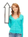 Teenage girl with direction arrow sign Royalty Free Stock Photography