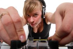 Teenage girl DJ adjusting sound levels Stock Photo