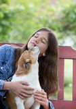 Teenage girl with dog Stock Images