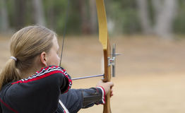 Teenage girl doing archery. Great image of a teenage girl doing archery stock photos