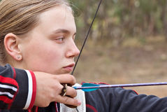 Teenage girl doing archery Royalty Free Stock Photography