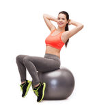 Teenage girl doing exercise on fitness ball Royalty Free Stock Photography