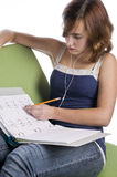 Teenage girl doing her homework Stock Photo