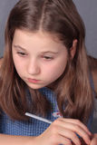 Teenage girl doing homework. Teenage girl 12-13 years old doing homework Royalty Free Stock Images