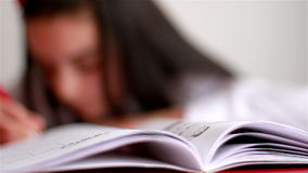 Teenage girl doing homework stock footage