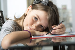 Teenage girl doing homework for school. A Teenage girl doing homework for school Stock Photography