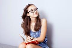 Teenage girl doing homework. Stock Photo