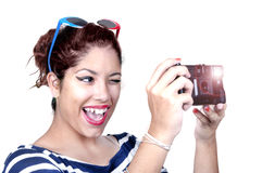Teenage girl doing photo camera Stock Photography