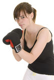 Teenage girl doing sport. Teenage girl with black and white outfit, wearing boxing gloves, in various positions for boxing or martial arts stock photos