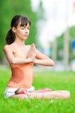 Teenage girl doing yoga exercise Royalty Free Stock Photography