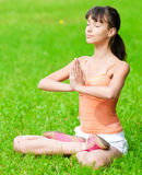 Teenage girl doing yoga exercise Stock Photography