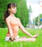 Teenage girl doing yoga exercise Stock Photos
