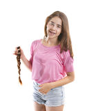 Teenage girl donating her hair to cancer patients Royalty Free Stock Images