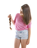 Teenage girl donating her hair to cancer patients Stock Image