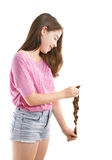 Teenage girl donating her hair to cancer patients Royalty Free Stock Photography