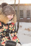 A teenage girl in a down jacket in winter, ice skating, Stock Images