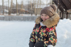 A teenage girl in a down jacket in winter, ice skating, Royalty Free Stock Images
