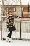 A teenage girl in a down jacket in winter, ice skating, Stock Photography