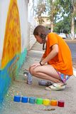 Teenage girl draw the graffiti. Teenage girl draw a graffiti on a wall Stock Photography