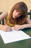 Teenage girl drawing on the paper Stock Photos